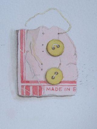 Buttons: torn pink card